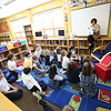 1:52 p.m. Holy Name of Jesus School, Medina: Librarian and sixth-grade teacher Kim Prodahl reads to second-graders in the library.