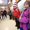 2:52 p.m. St. Timothy School, Maple Lake: Children get ready to leave the building and board their buses.