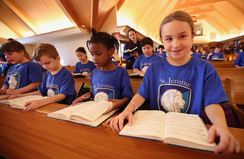 9:44 a.m. St. Jerome Catholic School, Maplewood: Students sing at the start of Mass.
