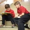 10:32 a.m. St. Rose of Lima School, Roseville: First-grader Braden Foley reads with fifth-grader Jackson Seebeck.