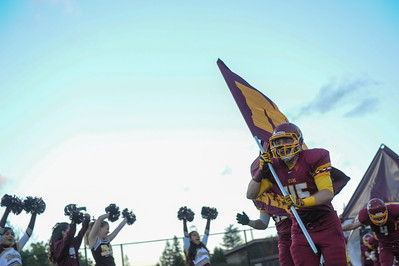 Menlo-Atherton Varsity Football team charges on the field just before playing St. Ignatius College Preparatory. 2013-09-20