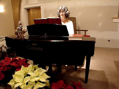 "Sue Foster plays the postlude while our church family shares ""the passing of the peace"""