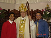 Toni, Bishop Wenski and his sponsor Adrian Nieves