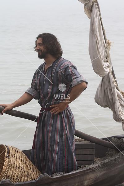 Fisherman in boat by jduran