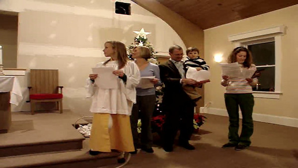 "Messier Family lights the Advent Wreathe and the congregation sings ""One Candle is Lit'"