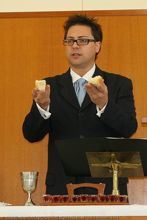 John Gill administers the sacrament of Holy Communion - churchlive.org - Windsor Uniting Church, Brisbane, Queensland, Australia, 2008.