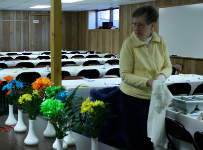Fresh flowers in Milk Glass vases, or sometimes an Open Bible with Silk Rose laying across it, decorated All Tables.