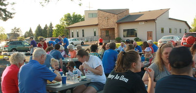 Food prepared and served by guys in blue, and enjoyed by everyone.