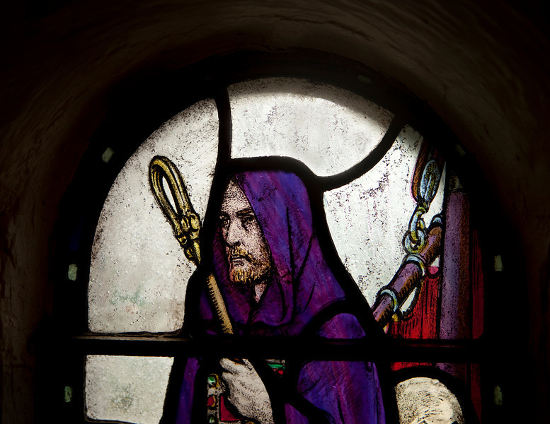 A representation of St. Columba in a cloak and with a shepherd's crook in an old stained glass window in St. Margaret's Chapel in Edinburgh castle. He was one of the 12 apostles of Ireland and, in his journeys, visited Scotland in the 6th century.