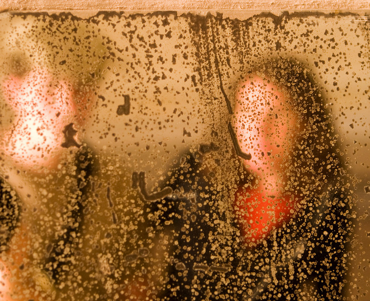 A reflection of two Jewish people in an old mirror, spotted with age, in one of the bathrooms at the Theresienstadt concentration camp in the Czech Republic. In a form of Impressionism, the ghostly image represents a reflection of two people but also a historical reminder of the memory of the Holocaust.