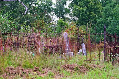 This is an old graveyard about 50 yards off the road requiring a 4 wheel drive to get to it. Its located in Putnam County Georgia.