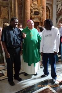 Bishop Morlino with Tafadzwa and his brother Tonde from England.