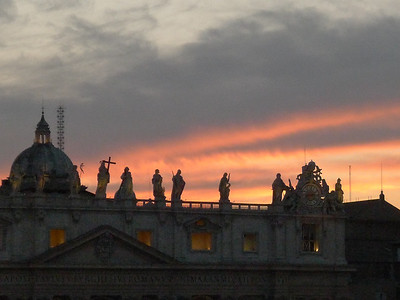 The statues at sunset atop St. Peter's