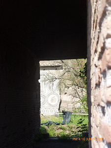 """Looking through a structure to a very detailed pattern """"across the street"""""""