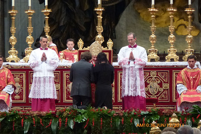 Holy Father visits with and blesses those bringing the gifts.
