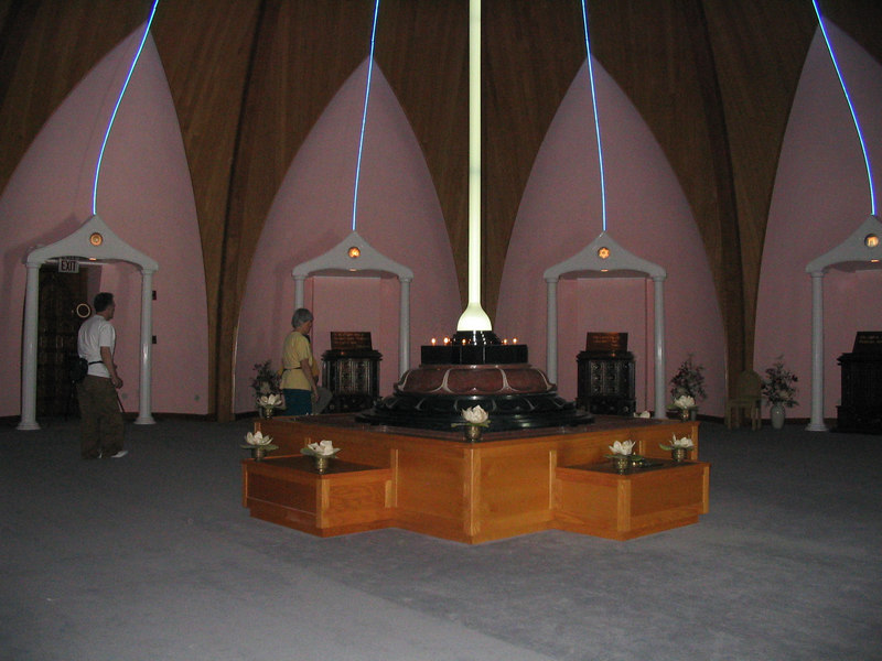A view of some of the altars that represent other known faiths and those that are still unknown.  Bonnie and William Osborn walk around to look at these altars.  May 2006.