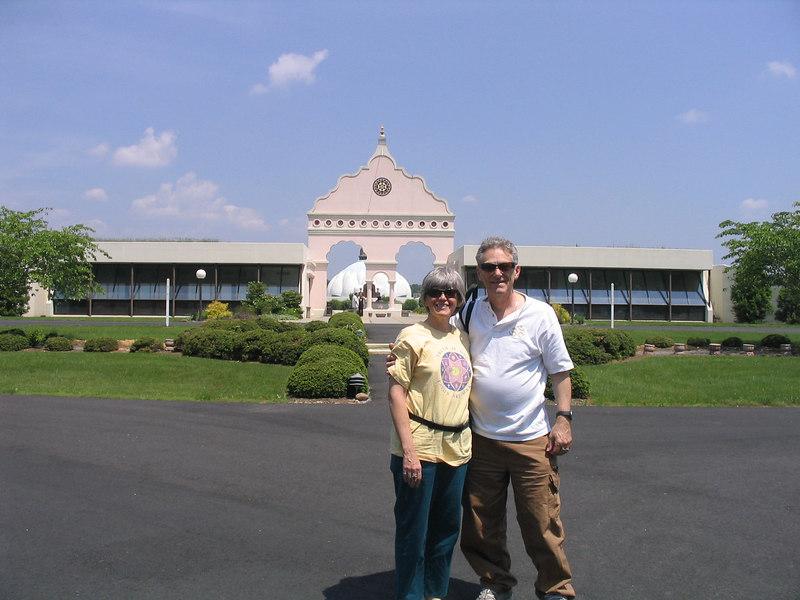 Bonnie and William Osborn in front of The LOTUS - Light of Truth Universal Shrine in Yogaville, Buckingham, VA.