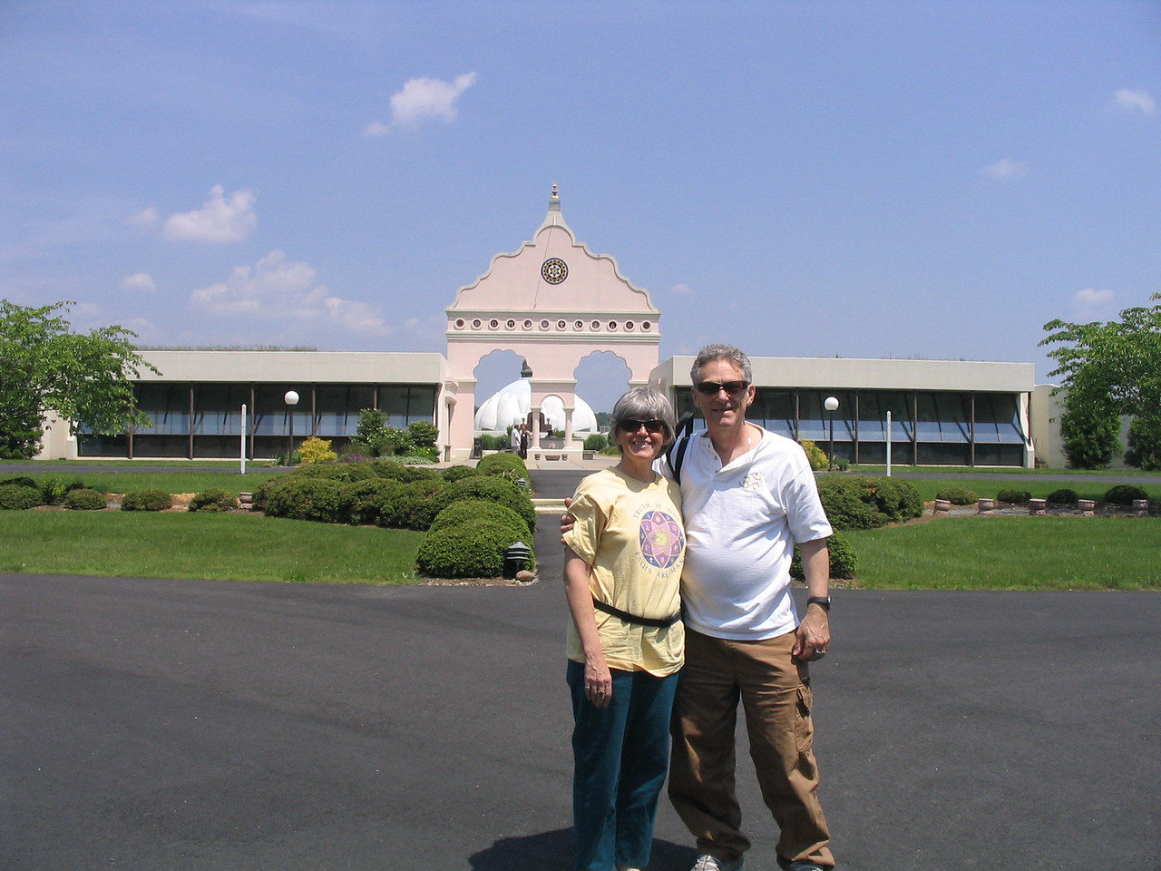Bonnie and William Osborn in front of The LOTUS - Light of Truth Universal Shrine in Yogaville, Buckingham, VA.