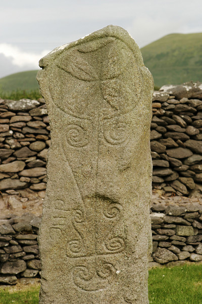 An ancient Celtic tombstone in an old monastery with many of the old decorations still showing. The Cross at the top was supposedly added later.. This was the tallest stone still standing -- the other ruins were all no more than the foundations from the old buildings.