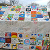 a patchwork tent sewn together from 1' x 1' patches - one side decorated by American kids, the other side by Darfuri refugee kids.  Our Micah patches are now in Chad and have been decorated by Darfuri children there.  They will soon be sewn together like this tent.