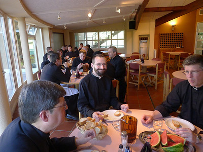Dinner in the refectory.  Ron on the left, Nathan smiling, Fr. John