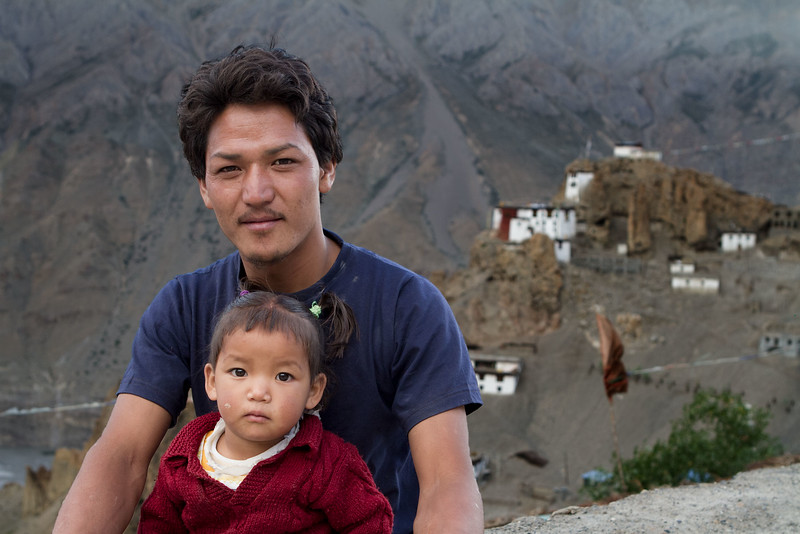 Father and daughter. Dhankar monastery and village (Spiti).