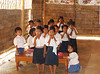 "In every class room children had prepared a song for us, and showed off their mastery of the English words ""Hello,"" ""Welcome,"" and ""Thank You."""