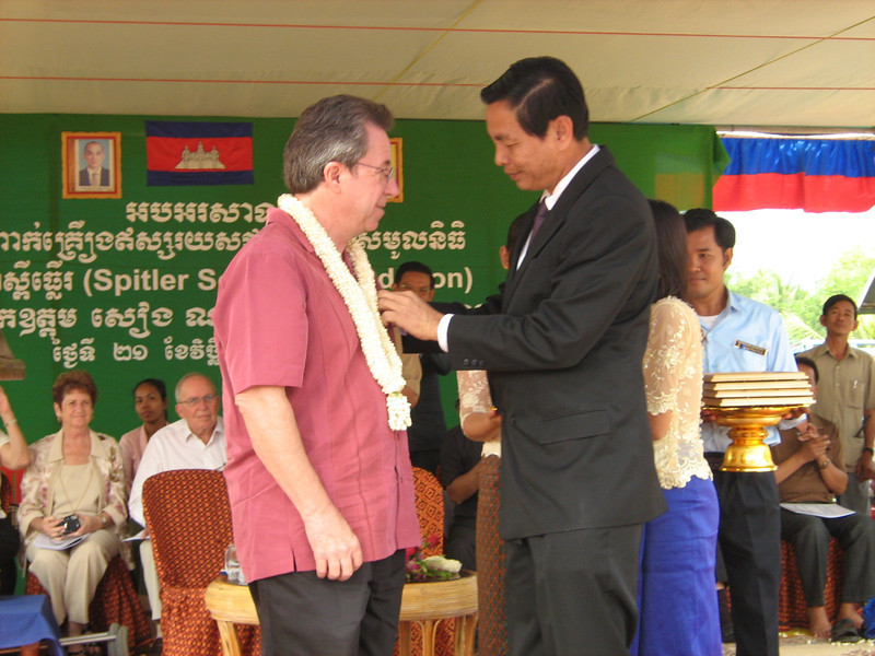 Dad, Pam and I were all presented with gold medals from the Cambodian government.