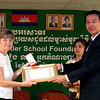 Pam accepts her medal and certificate from His Excellancy Sieng Num