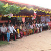 In addition to the brightly decorated stage Sarin had arranged for a canopy with seating for over a hundred so that all of the local villagers could attend the ceremony .