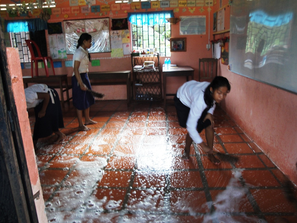 Scrubbing down the classroom.
