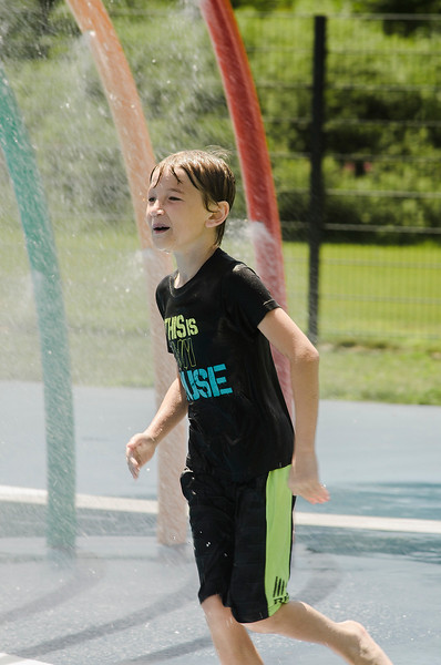 After a few chilly days of rain, Jayden Ash, 8, cools off at the splash park at Parkhill in Fitchburg as temperatures rose into the 80s again on Wednesday, July 26, 2017. SENTINEL & ENTERPRISE / Ashley Green