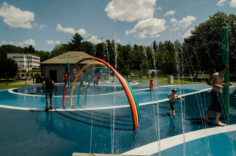 After a few chilly days of rain, kids cool off at the splash park at Parkhill in Fitchburg as temperatures rose into the 80s again on Wednesday, July 26, 2017. SENTINEL & ENTERPRISE / Ashley Green