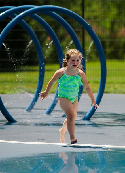 After a few chilly days of rain, Payton Tompkins, 4, cools off at the splash park at Parkhill in Fitchburg as temperatures rose into the 80s again on Wednesday, July 26, 2017. SENTINEL & ENTERPRISE / Ashley Green