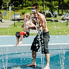 After a few chilly days of rain, Mark and Caleb Whitney, 2, cool off at the splash park at Parkhill in Fitchburg as temperatures rose into the 80s again on Wednesday, July 26, 2017. SENTINEL & ENTERPRISE / Ashley Green