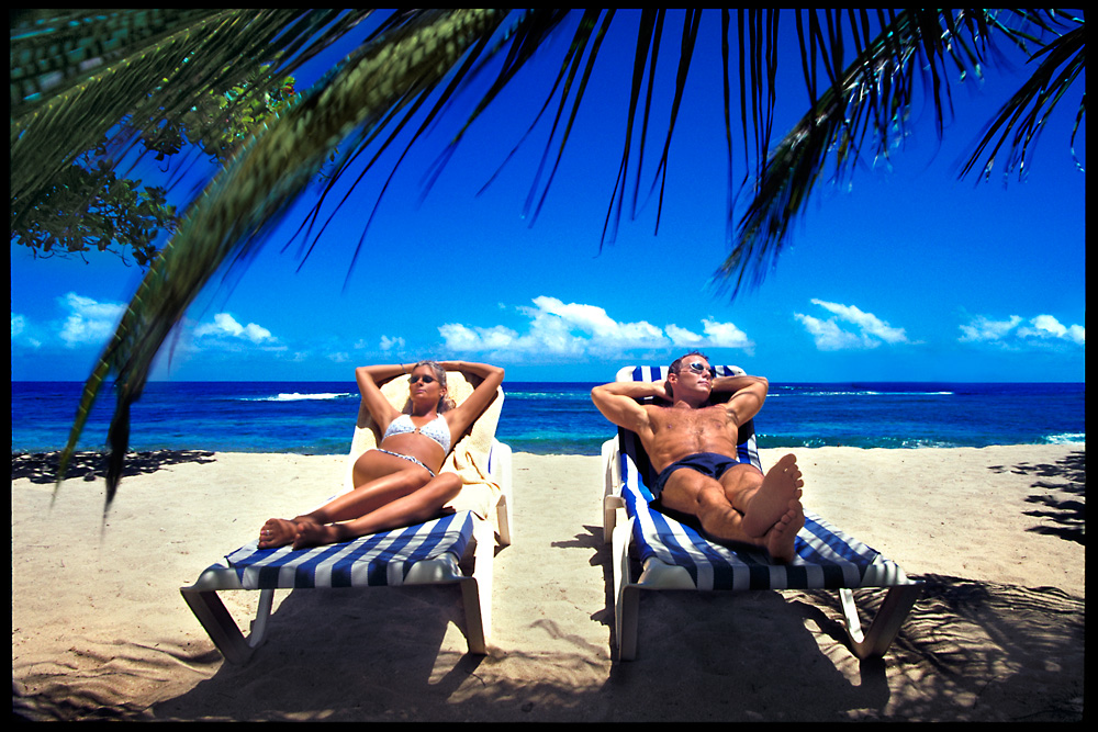 My sister Dawn and I relax on a beach in Haiti.  All that's missing is a bucket filled with Corona's.  The beach was so crowded, I had to bribe nearby beach go'ers to stay out of the picture!