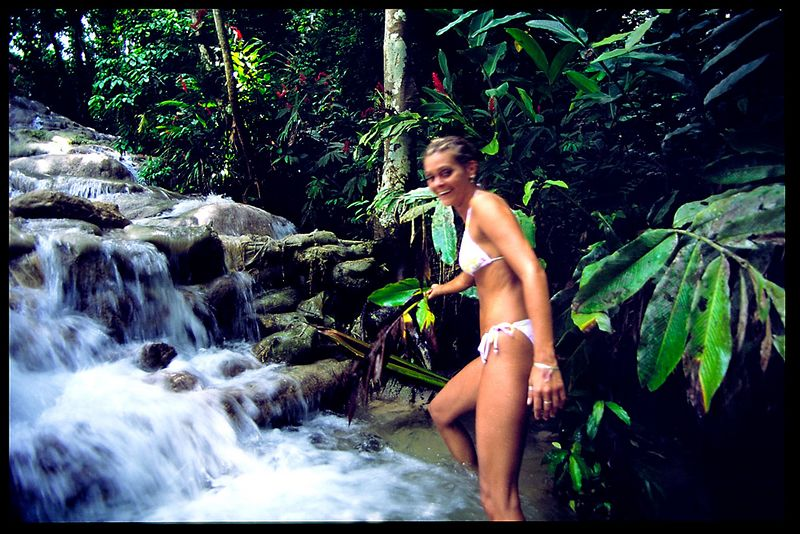 My sister Dawn and I hike up the falls in Jamaica.  I didn't think she'd be this adventurous.  This is shot on a simple mechanical SLR camera with no flash.  I had to use a long shutter speed given the low lighting under the canopy of trees.  I'm surprised it even came out this clear!