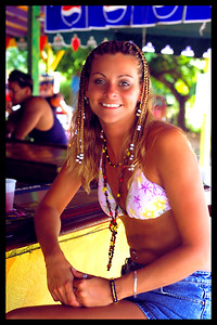 My sister Dawn and I stop at an authentic Jamaican eatery off the beaten path.  The colors and lighting caught my eye while sitting at the bar.  Dawn is sporting her freshly braided hair.  She tans so easily too... It's not fair.