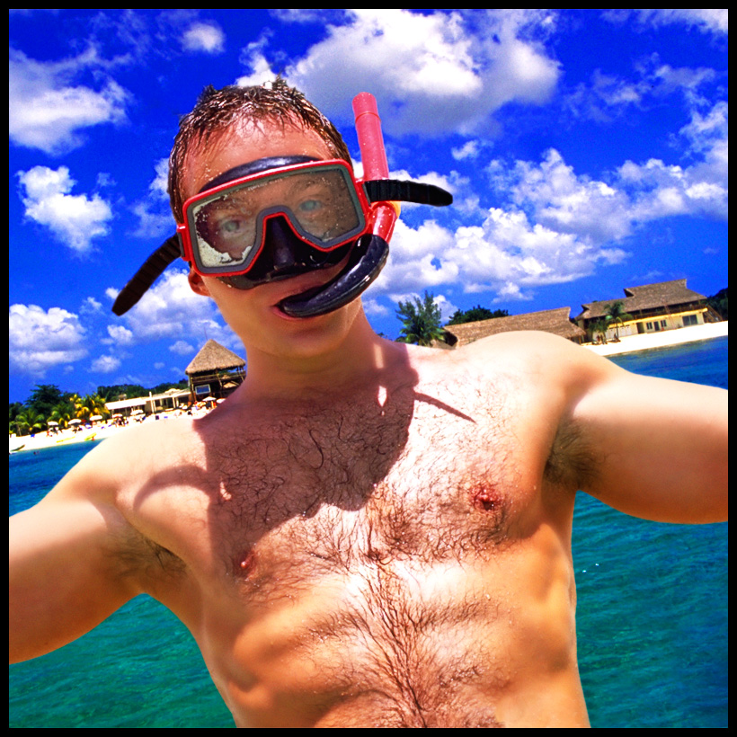 I fall backward into the clear waters off the coast of Cozumel.