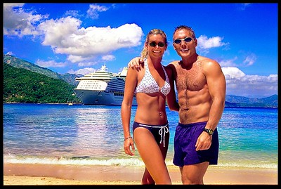 I set up the tripod on our first stop of our cruise in Haiti.  The water, the island, and our ship make for a perfect postcard shot.  The water really IS that blue.  And I really DID have those muscles.  And I really WAS that tan. But not any more (on all accounts)  :-(