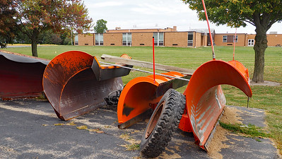 Waltham Township road equipment, with the Waltham School in the background
