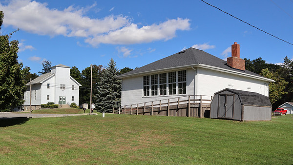 West Liberty Township Hall and church across the street