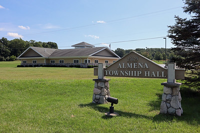 Almena Township Hall sign at driveway entrance