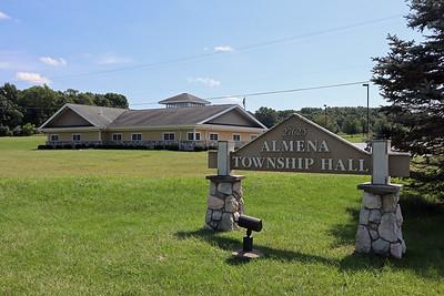 Almena Township Hall sign at driveway entrance