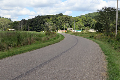 Approaching the intersection of Watson Creek Road and Crooked Creek Road, where the Rush Townshp building is located