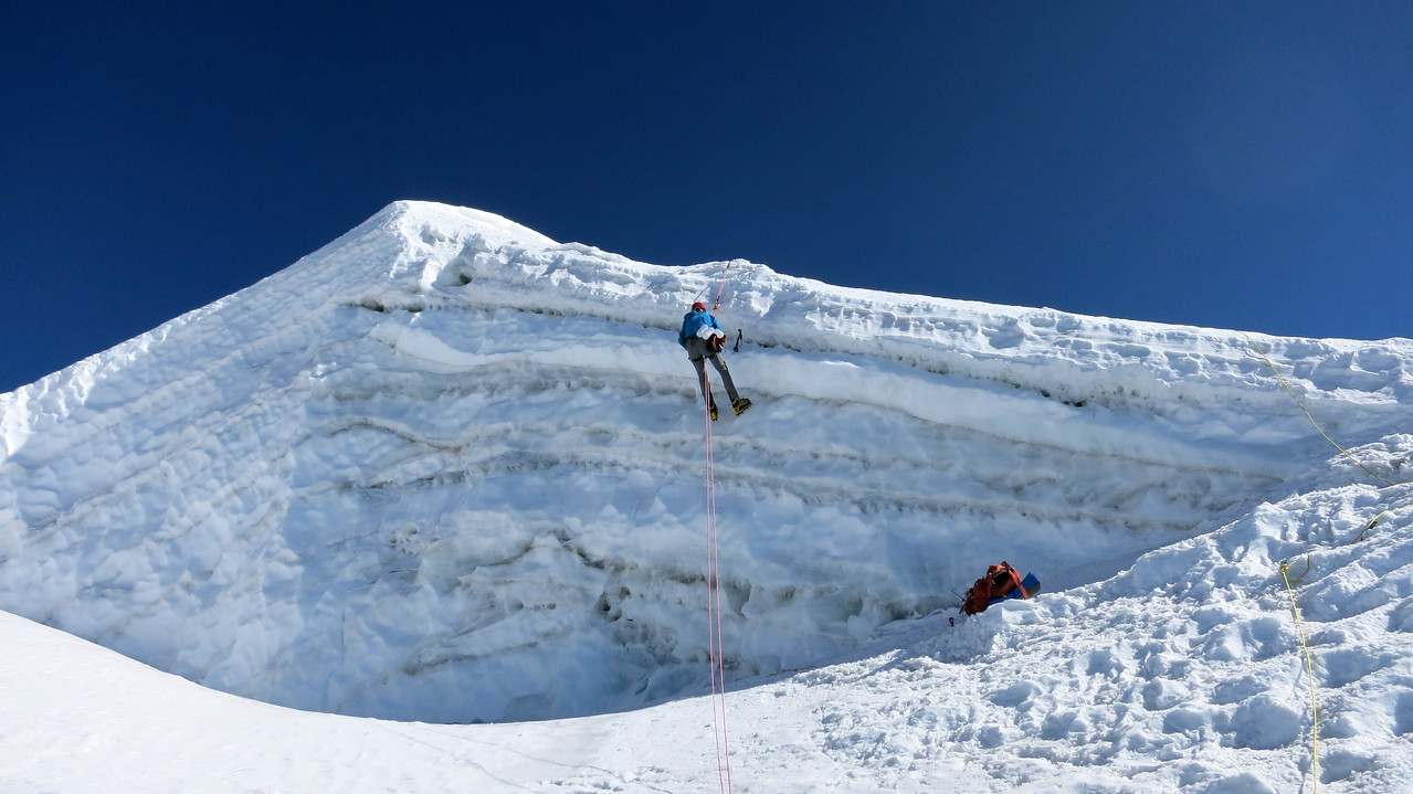 I rappelled over the lip of a crevasse to sample snow for climate research.