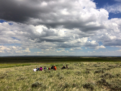 The Adventurers and Scientists for Conservation Landmark crew takes a lunch break during a training hike. The crew walks 10 miles a day to collect data on wildlife including mule deer, bison, elk and sage grouse for the American Prairie Reserve. Learn more about becoming an adventure scientist at www.adventurescience.org/landmark