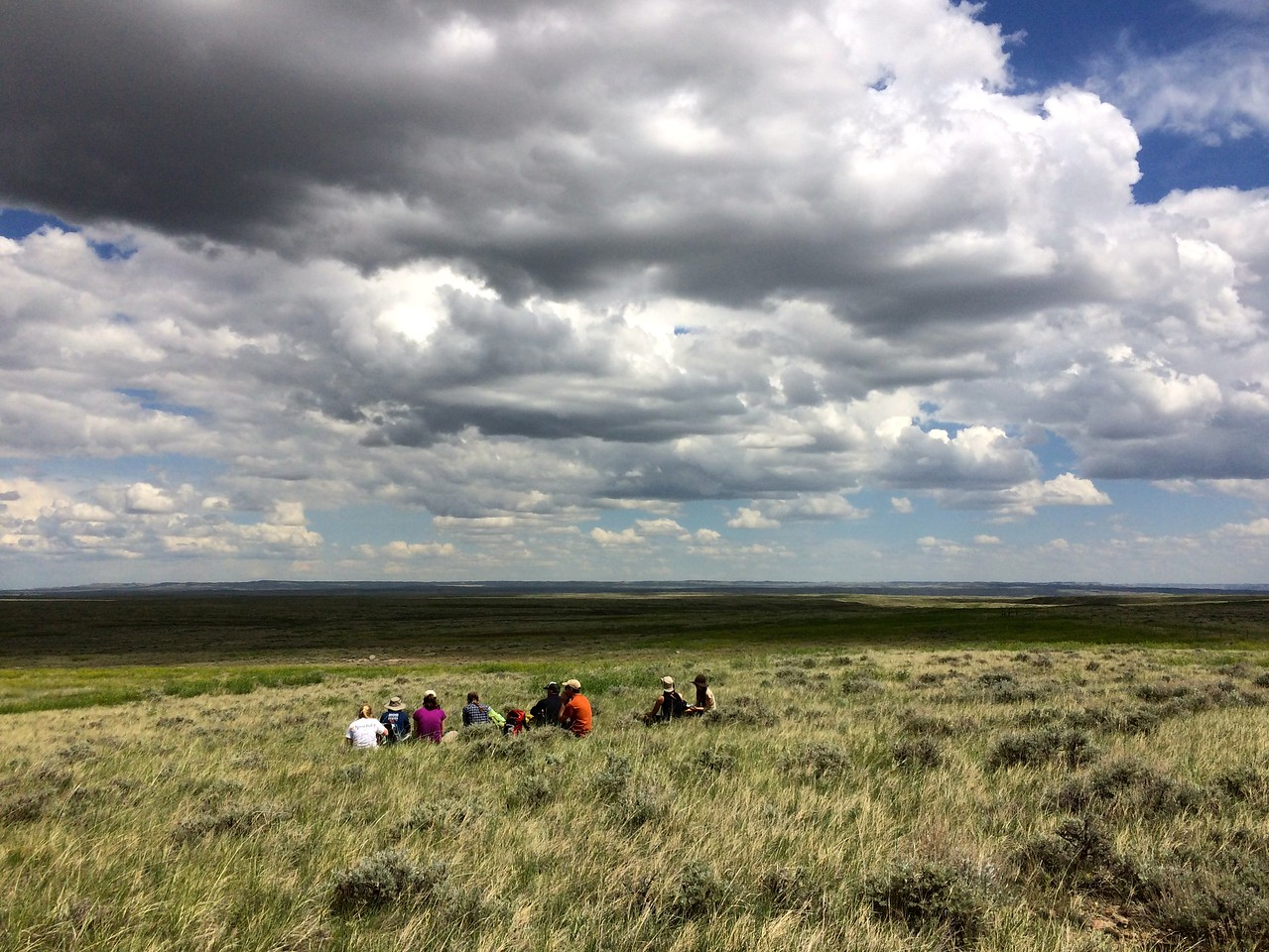 """The Adventurers and Scientists for Conservation Landmark crew takes a lunch break during a training hike. The crew walks 10 miles a day to collect data on wildlife including mule deer, bison, elk and sage grouse for the American Prairie Reserve. Learn more about becoming an adventure scientist at  <a href=""""http://www.adventurescience.org/landmark"""">http://www.adventurescience.org/landmark</a>"""