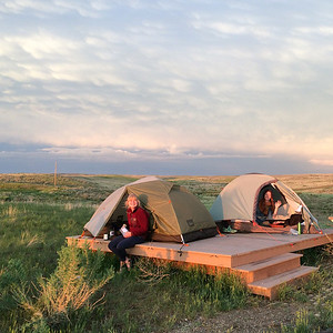 Alex Guest and Rachel Herring from the June 2014 crew settle into Buffalo Camp during their first night on the reserve. PHOTO BY EMILY WOLFE