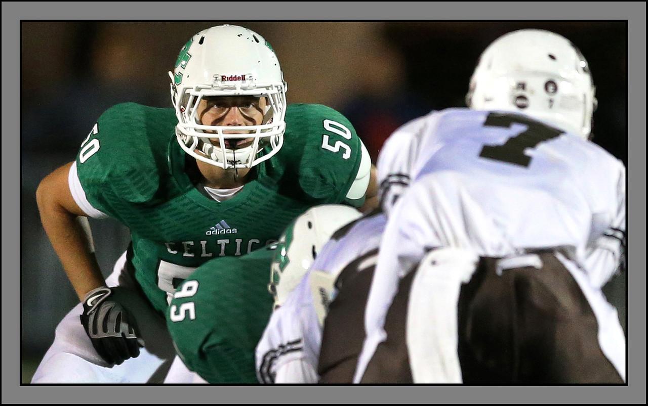 Providence's Jimmy Sharkey eyes Mount Carmel's quarterback, Anthony Thompson, September 12, 2014. | Allen Cunningham/For Sun-Times Media